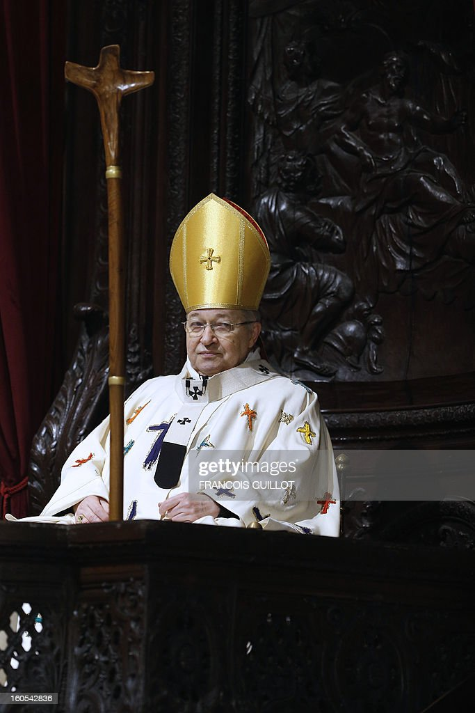 Paris Archbishop Andre Vingt-Trois attends a mass at Paris' Notre-Dame de Paris Cathedral during which he blessed the church's nine new bells on February 2, 2013 in Paris.