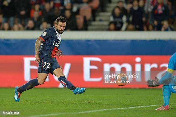 Paris' Argentine forward Ezequiel Lavezzi scores his team's opening goal past Valenciennes' goalkeeper Nicolas Penneteau during the French L1...