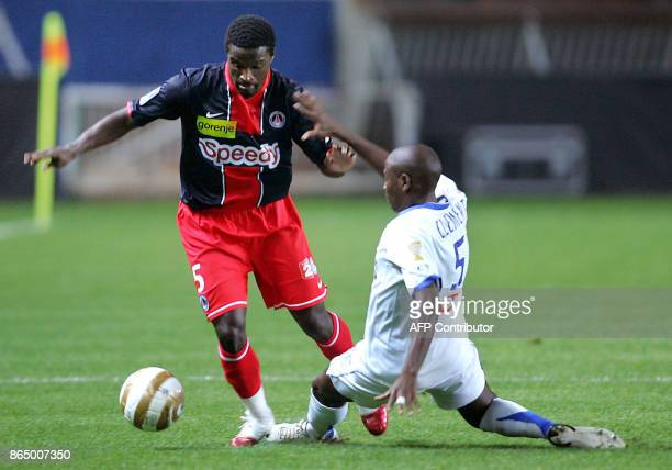 Paris' Bernard Mendy vies with Montpellier's defender Ludovic Clement during the French League Cup football match Paris SaintGermain vs Montpellier...