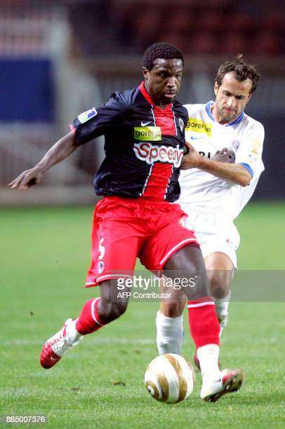 Paris' Bernard Mendy vies with Montpellier's Philippe Delaye during the French League Cup football match Paris SaintGermain vs Montpellier 31 October...