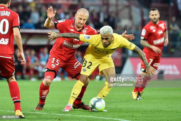 Paris' Brazilian defender Daniel Alves vies with Dijon's French midfielder Florent Balmont during the French L1 football match between Dijon and...
