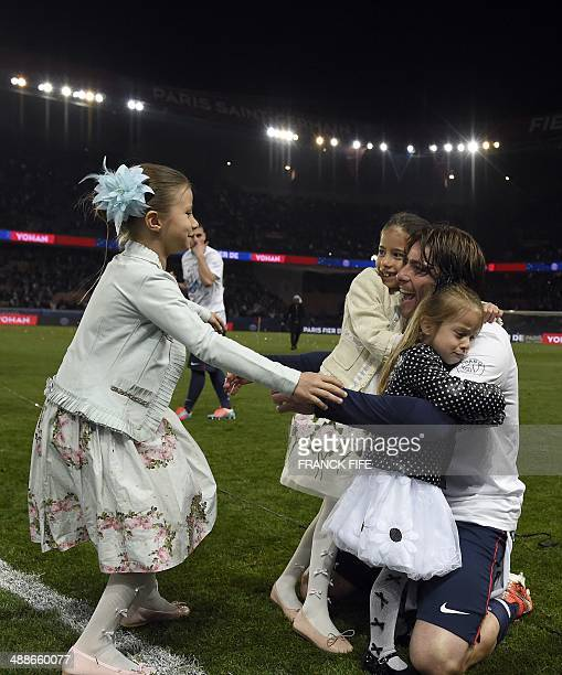 Paris' Brazilian defender Maxwell celebrate wit children after the French L1 football match Paris SaintGermain vs Rennes at the Parc Des Princes...