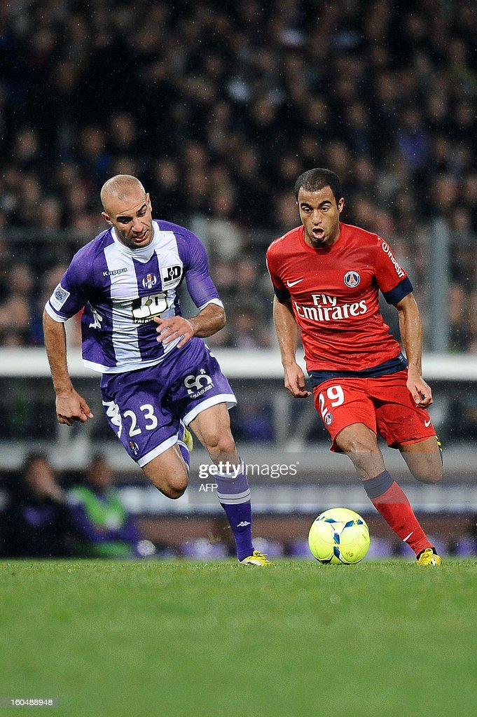 Paris' Brazilian forward Lucas Moura (R) fights for the ball with Toulouse's Ali Ahamada (L) during the French L1 football match Toulouse (TFC) vs Paris Saint-Germain (PSG) on February 1, 2013 at the Stade Municipal in Toulouse. AFP PHOTO / REMY GABALDA