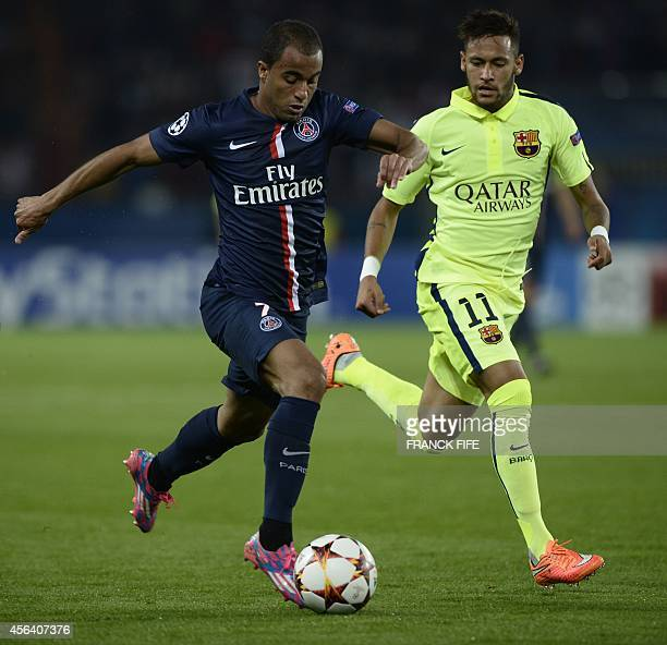 Paris' Brazilian forward Lucas Moura vies with Barcelona's Brazilian forward Neymar during the UEFA Champions League football match Paris...