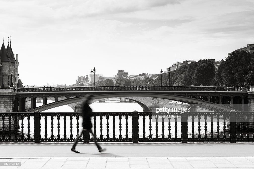 Paris bridge with commuter