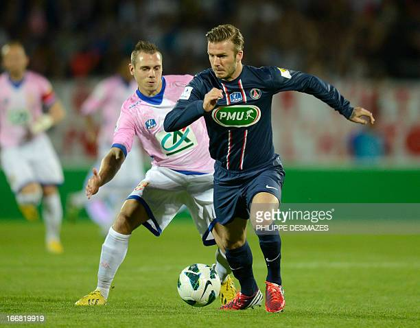 Paris' British midfielder David Beckham fights for the ball with Evian's French forward Kevin Berigaud during the French Cup quarter final football...