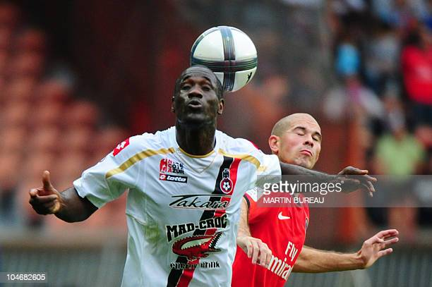 Paris' Christophe Jallet fights for the ball with Nice's Abdou Traore during the French L1 football match PSG vs Nice on October 3 2010 at the Parc...