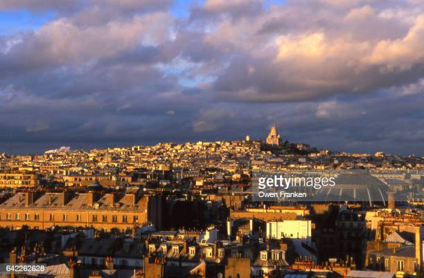 Paris cityscape of Monmartre and Sacre Coeur at sunset