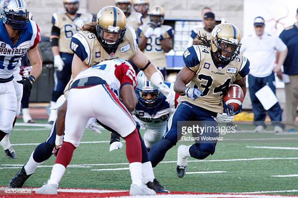 Paris Cotton of the Winnipeg Blue Bombers rushes with the ball during the CFL against the Montreal Alouettes game at Percival Molson Stadium on July...