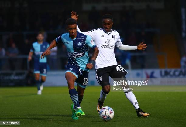 Paris CowanHall of Wycombe Wanderers and Steven Sessegnon of Fulham battle for possesion during the Carabao Cup First Round match between Wycombe...