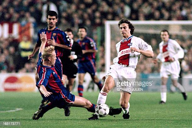 BERNAL Paris' David Ginola is tackled by Barcelona's Ronald Koeman during the Champions League quarter final football match PSG vs FC Barcelona on...
