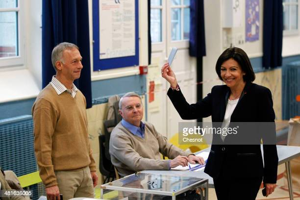 Paris Deputy Mayor and French Socialist party candidate for the Paris municipal elections Anne Hidalgo poses as she casts her ballot in the second...
