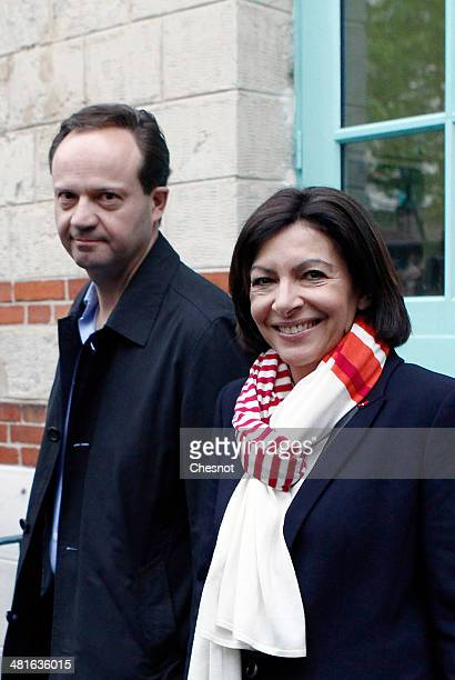 Paris Deputy Mayor and French Socialist party candidate for the Paris municipal elections Anne Hidalgo leaves with her husband JeanMarc Germain after...