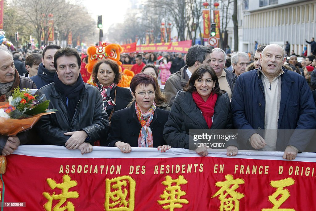 Paris' deputy Mayor and socialist party candidate for the 2014 municipal elections, Anne Hidalgo (2ndR) and French socialist MP Jean-Marie Le Guen (R) take part in a parade on February 17, 2013 in Paris as part of the Chinese New Year celebrations. Chinese communities world wide traditionally welcomed in the 'Year of the Snake'.