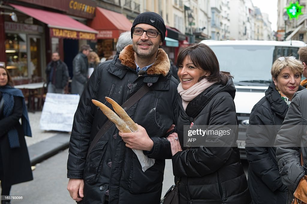 Paris Deputy Mayor and socialist party candidate in the 2014 municipal elections Anne Hidalgo visits a Paris neighbourhood as part of her campaign in Paris on March 16, 2013.