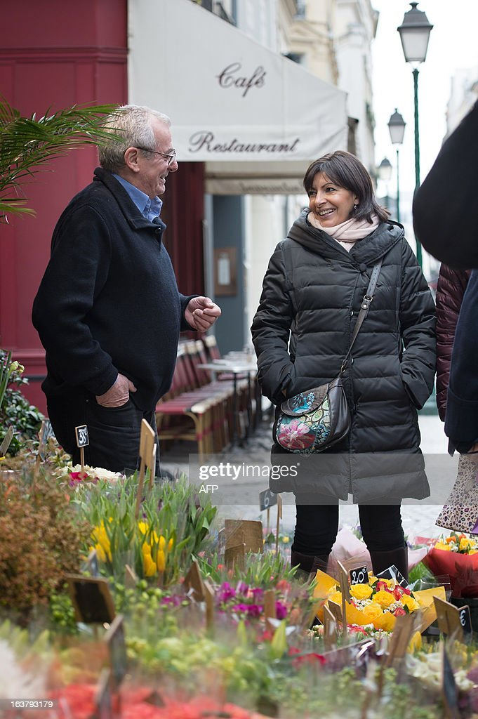 Paris Deputy Mayor and socialist party candidate in the 2014 municipal elections Anne Hidalgo visits a neighbourhood florist as part of her campaign in Paris on March 16, 2013.
