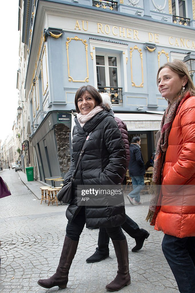 Paris Deputy Mayor and socialist party candidate in the 2014 municipal elections Anne Hidalgo (L) visits a neighbourhood in Paris as part of her campaign on March 16, 2013.