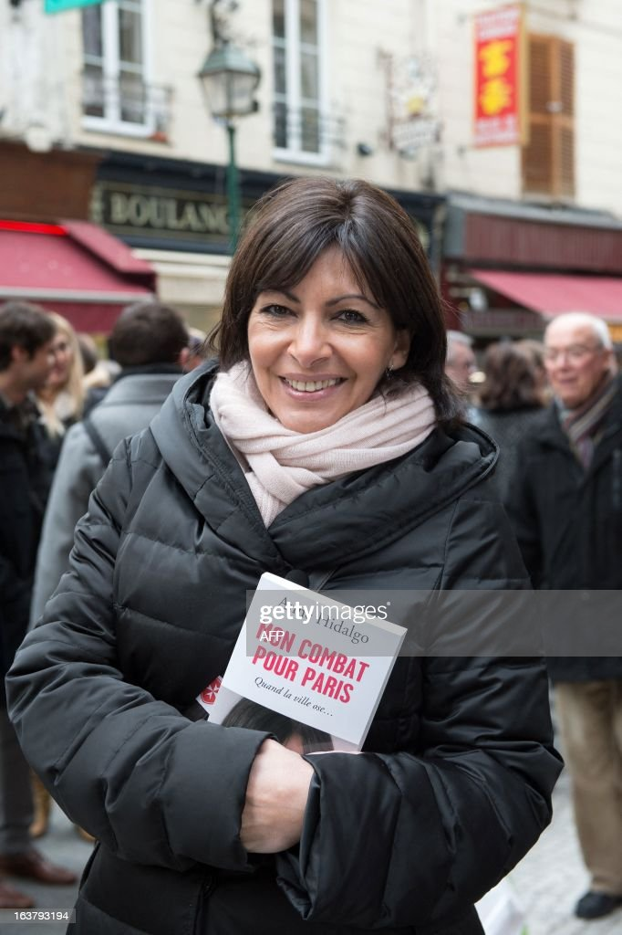 Paris Deputy Mayor and socialist party candidate in the 2014 municipal elections Anne Hidalgo poses as she visits a Paris neighbourhood as part of her campaign in Paris on March 16, 2013.