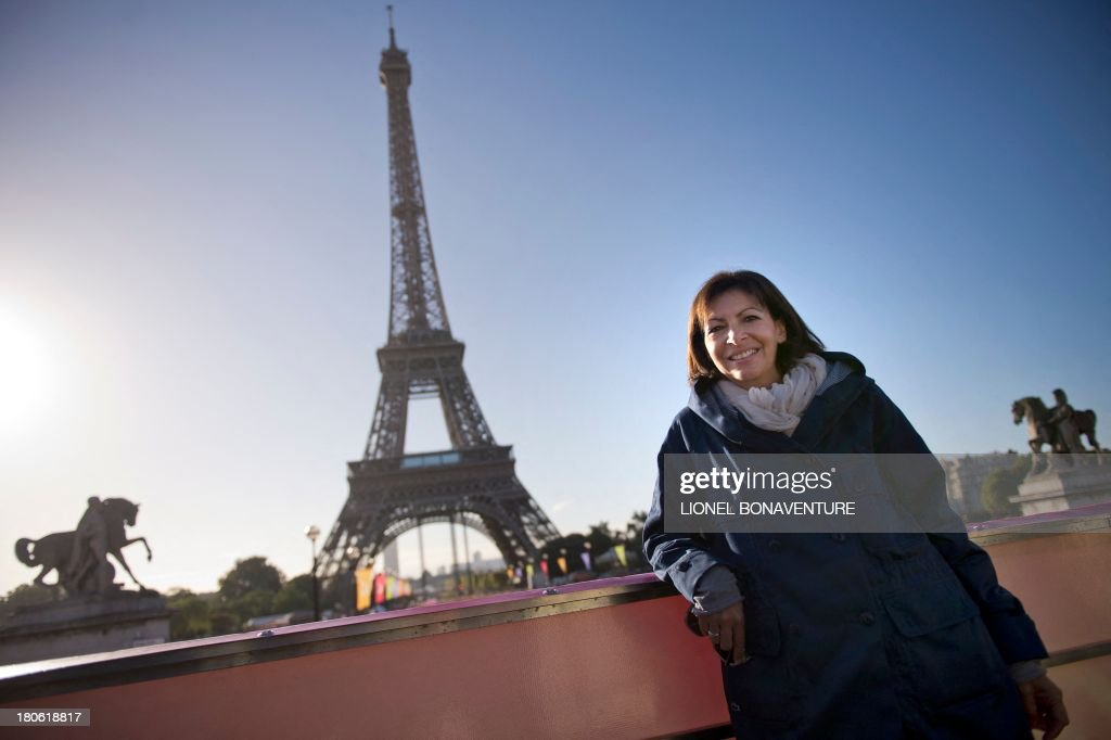 Paris deputy mayor Anne Hidalgo poses in front of the Eiffel Tower in Paris on September 15, 2013 before the start of the race 'La Parisienne'.