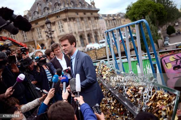 Paris Deputy Mayor Bruno Julliard speaks to journalists during the removal of love padlocks attached on the railings of the Pont des Arts on June 1...