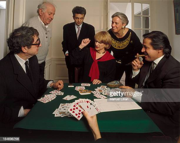Paris February 8 1993 Francoise Sagan her home in Paris playing cards with his friends including Marc Francelet Bernard Frank