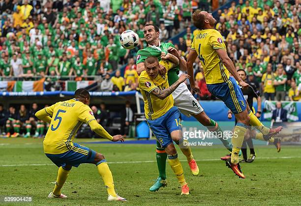 Paris France 13 June 2016 John O'Shea of Republic of Ireland in action against Victor Lindelöf of Sweden during the UEFA Euro 2016 Group E match...