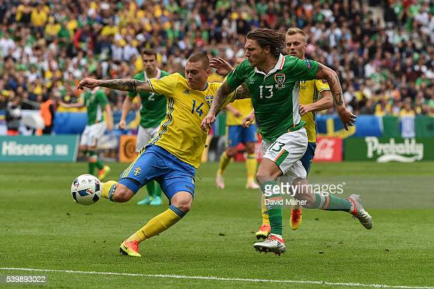 Paris France 13 June 2016 Victor Lindelöf of Sweden in action against Jeff Hendrick of Republic of Ireland during the UEFA Euro 2016 Group E match...