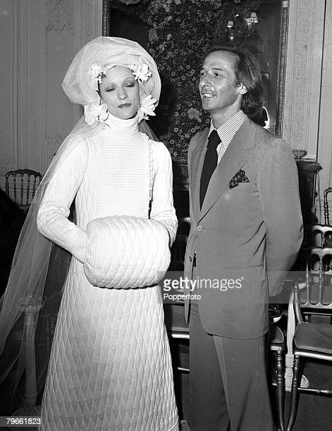 Paris France 23rd July 1970 French fashion designer Marc Bohan has a look at his wedding dress created for the House of Dior modelled at their Paris...