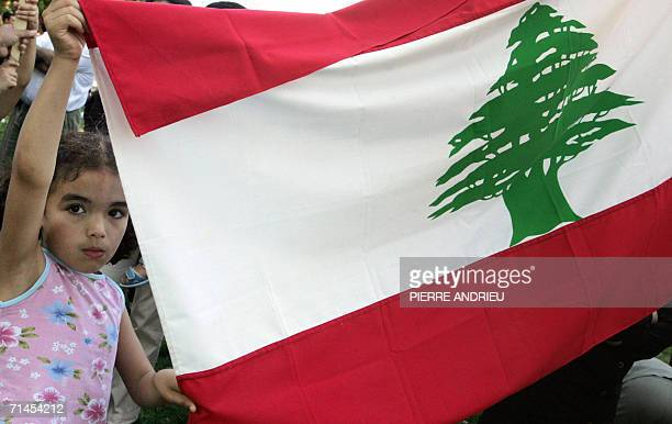 A child holds a lebanese flag during a demonstration to denounce the Israeli attacks in Lebanon 15 July 2006 in Paris Foreign governments were...