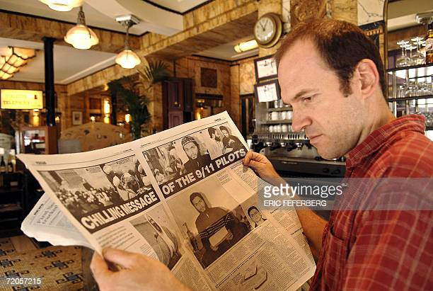 A man reads the Sunday Times British newspaper 01 October 2006 in a Parisian cafe The Sunday Times claimed today it had obtained a copy of a film...
