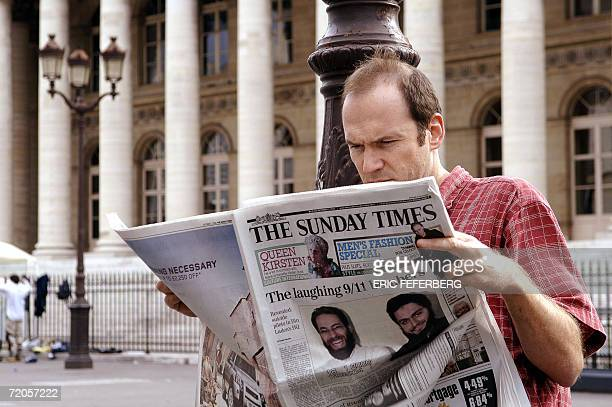 A man reads the Sunday Times British newspaper 01 October 2006 in the center of Paris The Sunday Times claimed today it had obtained a copy of a film...