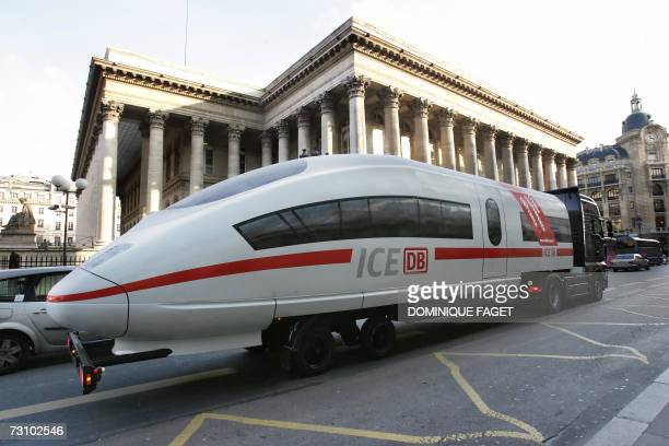 A model of the ICE high speed train of Germany's railway operator Deutsche Bahn is transported on a truck 25 January in Paris as this is the 10th...