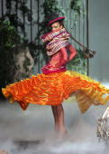 A model presents a creation by British designer John Galliano for Dior during the Autumn/Winter 200506 Haute Couture collections 06 July 2005 AFP...