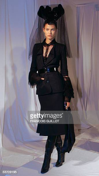 A model presents a creation by Italian designer Riccardo Tisci for Givenchy during the Autumn/Winter 200506 Haute Couture collections 07 July 2005 in...