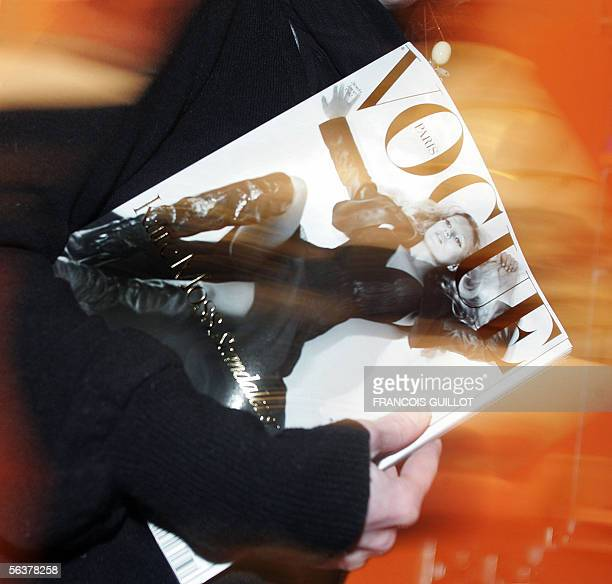 A person holds the special December issue of French Vogue featuring British model Kate Moss 08 December 2005 in Paris France The British supermodel...