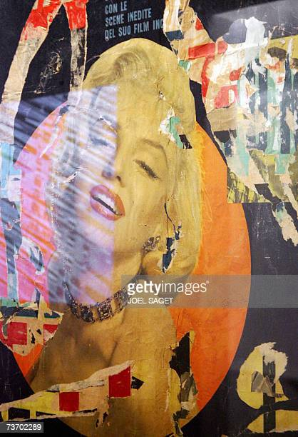 A picture shows the installation 'Marilyn Monroe' by Italian Mimmo Rotella during the exhibition 'New Realism' 26 March 2007 at Le Grand Palais...