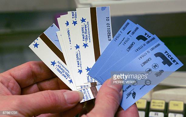 A RATP employee shows a special edition of subway tickets as part of the celebrations of the Europe Day 09 May 2006 in Paris AFP PHOTO PIERRE VERDY