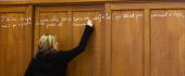A student protesting against the First Employment Contract writes on a wall the lyrics of a song by French singer Renaud as she takes part in the...