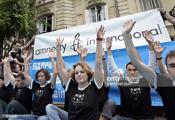 Amnesty International members participate in a symbolic blockade action during a demonstration 15 September 2006 in front of Soudan's Embassy in...