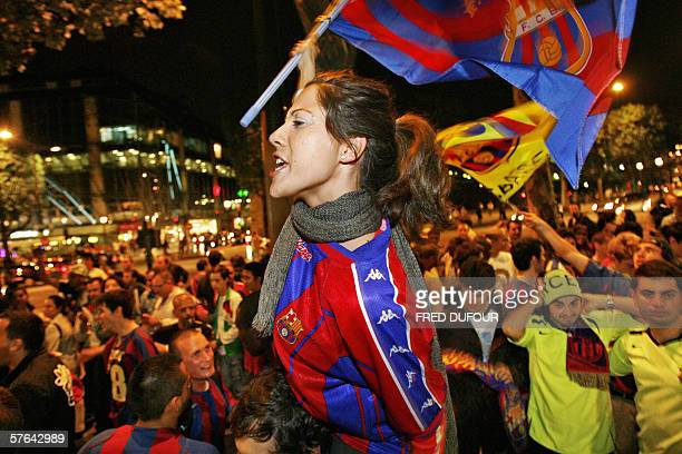 Barcelona supporters celebrate 17 May 2006 on the ChampsElysee Avenue in Paris Barcelona football team won the UEFA Champions League football final...