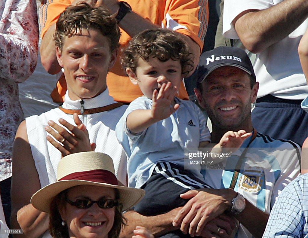 Belgian Justine HeninHardenne's husband PierreYves and her coach Carlos Rodriguez applaud after she defeated Russian Svetlana Kuznetsova during the...