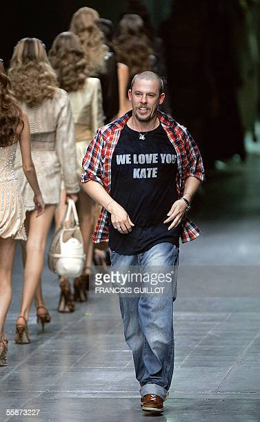 British designer Alexander McQueen salutes at the end of his show during the Spring/Summer 2006 ReadytoWear collections in Paris 07 October 2005 AFP...