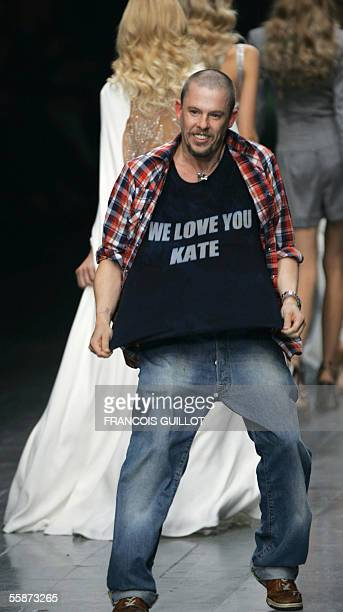 British designer Alexander McQueen shows off his Tshirt in support of British model Kate Moss at the end of his Spring/Summer 2006 ReadytoWear...
