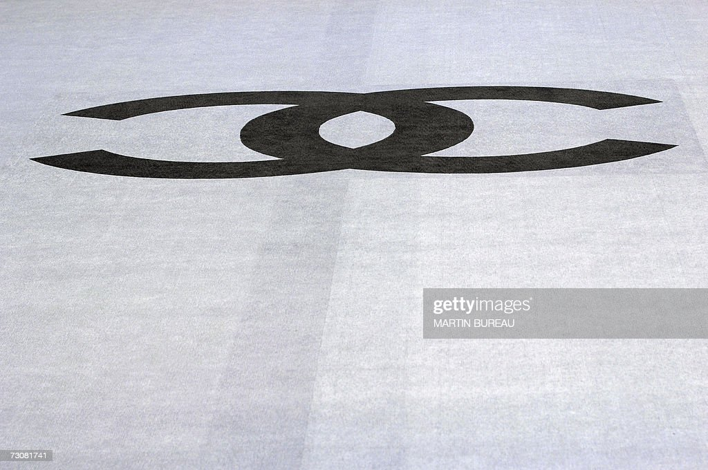 Chanel's logo is seen on a carpet prior Spring-Summer 2007 Haute Couture show in Paris, 23 January 2007.