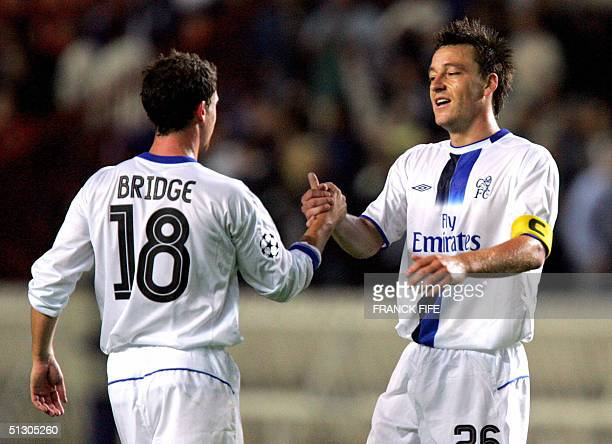 Chelsea's captain John Terry celebrates with his teammate Wayne Bridge 14 September 2004 at the Parc des Princes stadium in Paris after winning the...