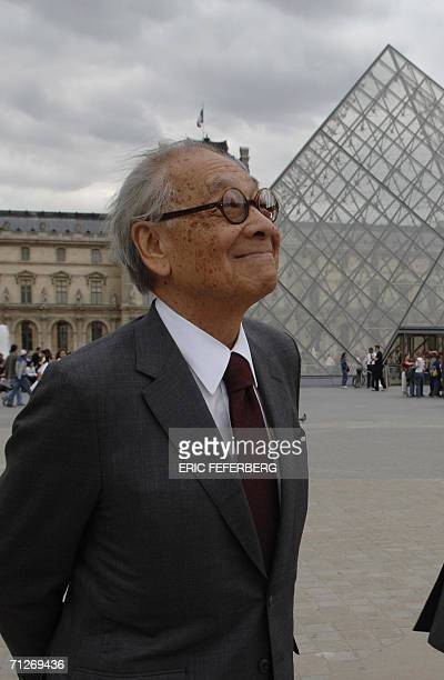 Chinese architect of the Louvre Pyramid Ieoh Ming Pei smiles in the Napoleon courtyard of the Louvre museum 22 June 2006 in Paris The glass Pyramid...