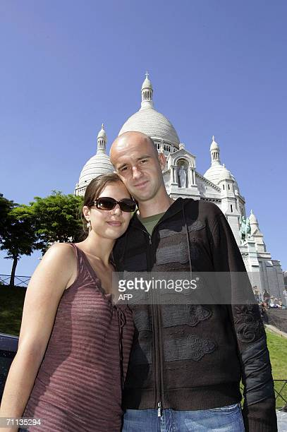 Croatia's tennis player Ivan Ljubicic and his wife Aida pose in front of the Sacre Coeur basilica during the French Open tennis tournament at Roland...