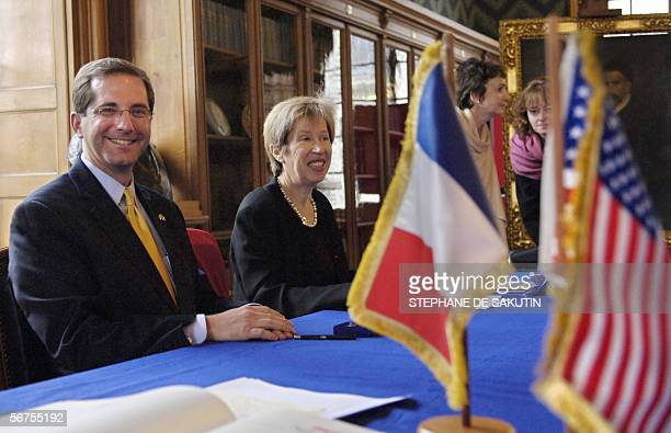 Director of French research laboratory the Pasteur Institute Alice Dautry smiles next to US Deputy Secretary of Health and Human Services Alex Azar...