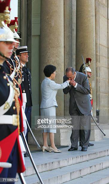 France President Jacques Chirac kisses the hand of South Korea Prime Minister Han MyungSook after a meeting at the Elysee Palace 08 June 2006 in...