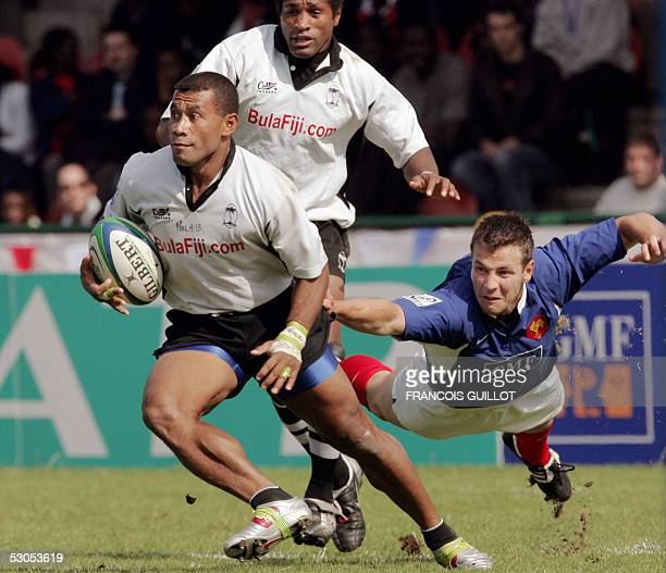 France's Nicolas Carmona tries to tackle Fiji's Waisale Serevi during the Paris leg of the IRB World Series rugby sevens final match France vs Fiji...